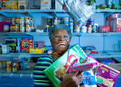 Inside the trailer that houses the Friendship Foundation Food & Clothing Pantry, Gloria Banks shows off her wares.